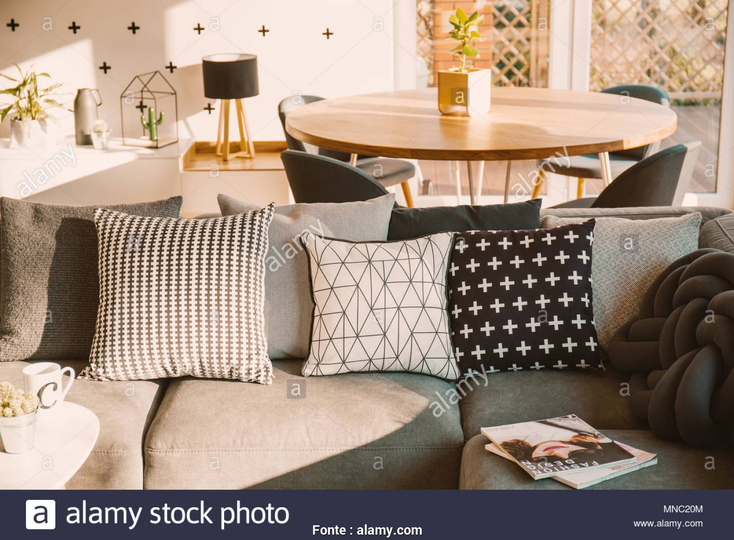 Cuscini Divano Sfondati, Affascinante Black, White Decorative Pillows On A Gray Sofa In A Sunlit Living Room Interior With A Wooden Dining Table